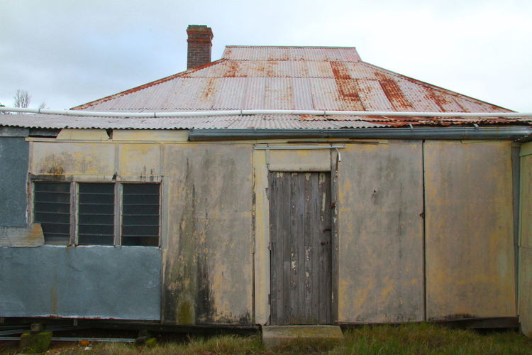 Love the colour contrasts on this old house Rustic Abandoned Architecture Asbestos House Building Building Exterior Built Structure Damaged Day Decline Deterioration House Iron Metal Nature No People Obsolete Old Outdoors Ruined Run-down Rusty Sky Tin Roof Rusted Weathered