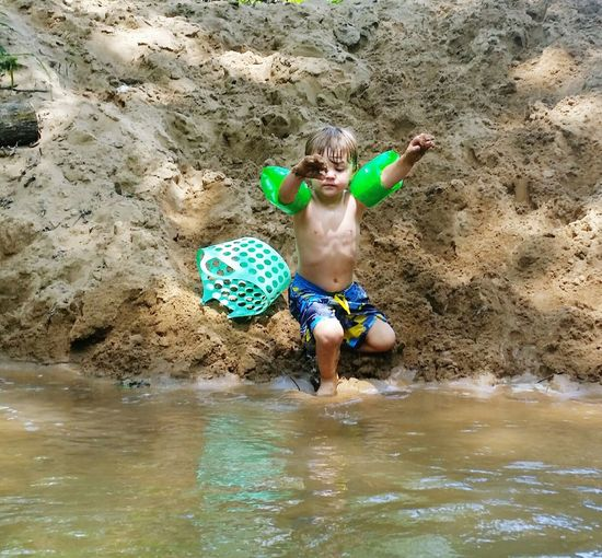 Boy With Water Wings By River