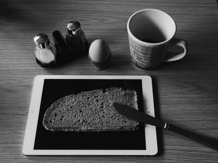 Table knife and bread on digital tablet