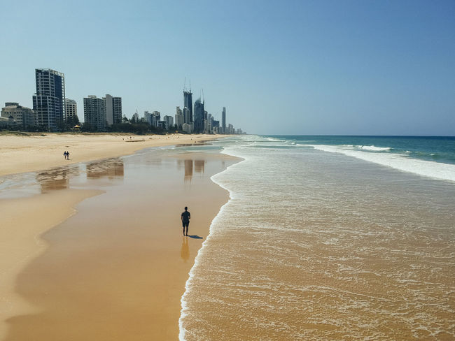 Gold Coast Australia Queensland Water Sea Beach Land Sky Sand Architecture Nature Clear Sky Beauty In Nature Leisure Activity Horizon One Person Horizon Over Water Building Exterior Built Structure City Scenics - Nature Vacations Outdoors