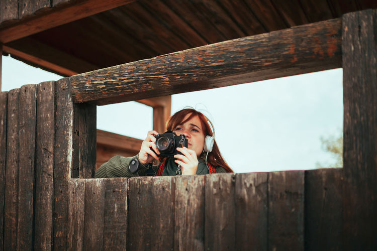 Woman holding camera at observation point