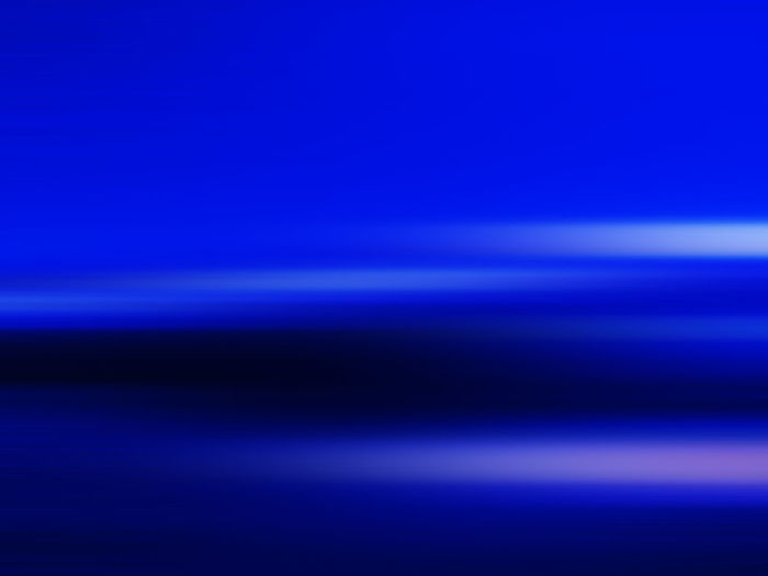 Defocused image of illuminated blue sky