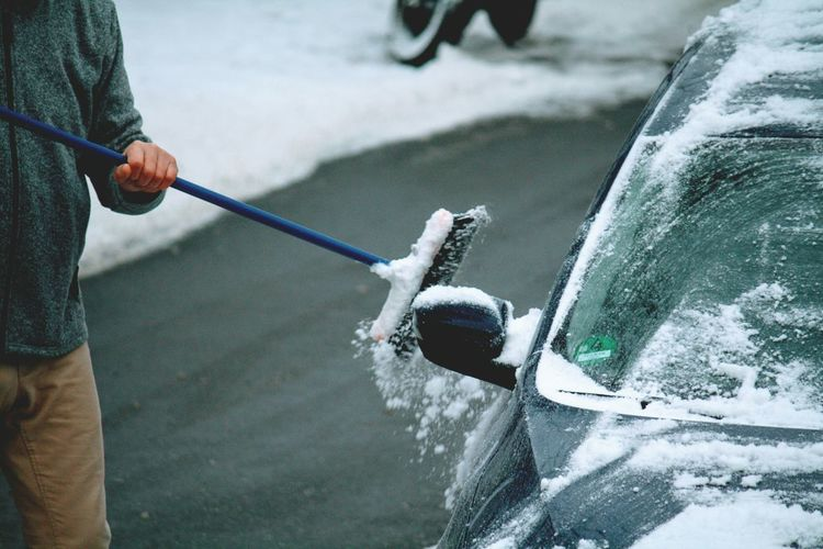 Cold Temperature One Person Winter Playing Ice Close-up People Adults Only Human Body Part Human Hand Outdoors Snow Adult Water One Man Only Day Snow Cleaning Wintertime Urban Winter Cleaning Car