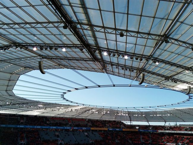 roof of a stadium stadion and clear blue sky Stadium Stadion Arena Sports Arena Soccer Arena Roof Steel Construction Glas Transparent Clear Sky Blue Sky No People Indoors  Day Architecture Stadium Built Structure Sport Sky
