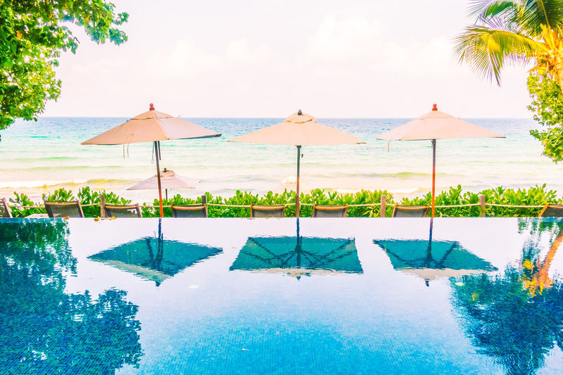 Beach Beauty In Nature Day Nature No People Outdoors Relaxation Scenics Sea Sky Swimming Pool Tourist Resort Tranquil Scene Tranquility Tree Vacations Water