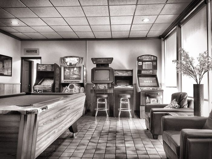 The Trucker's Lounge - the semi truck had a blown tire so while we waited I walked the lounge. USA Travel Phone Edits IPhone 8 IPhoneography Boredom! Truck Lounge Pool Table Retro Games Gameroom Architecture No People Furniture Table Day Chair