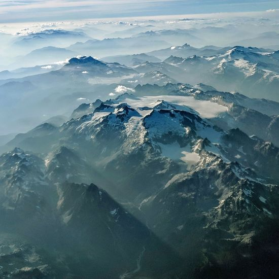 Mountains in British Columbia, Canada. Birds eye view through plane window. God Rays Mountain Range Mountains Astronomy Water Space Planet Earth Sea Wave Mountain Blue Aerial View Above