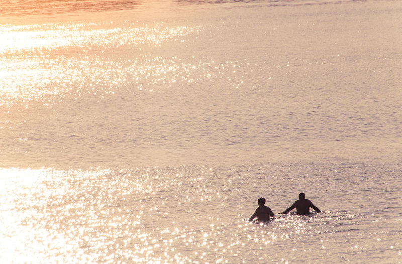 Silhouette couple on beach