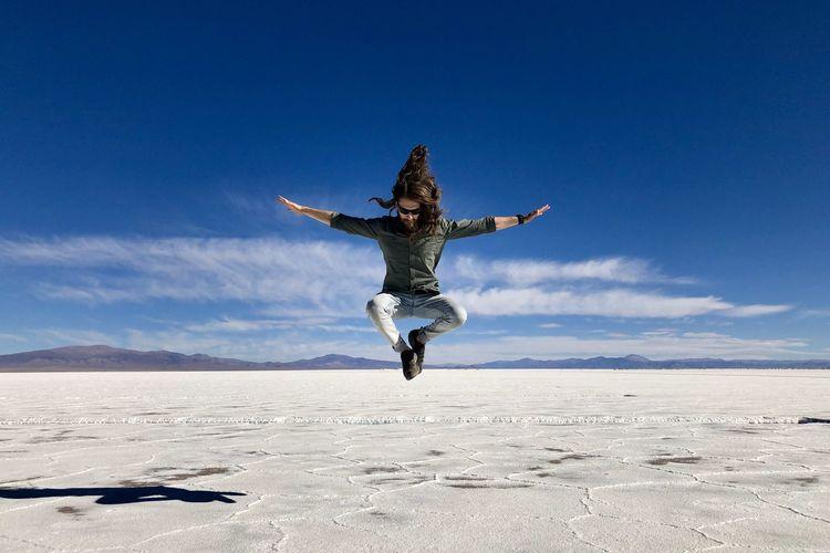 Man jumping in desert