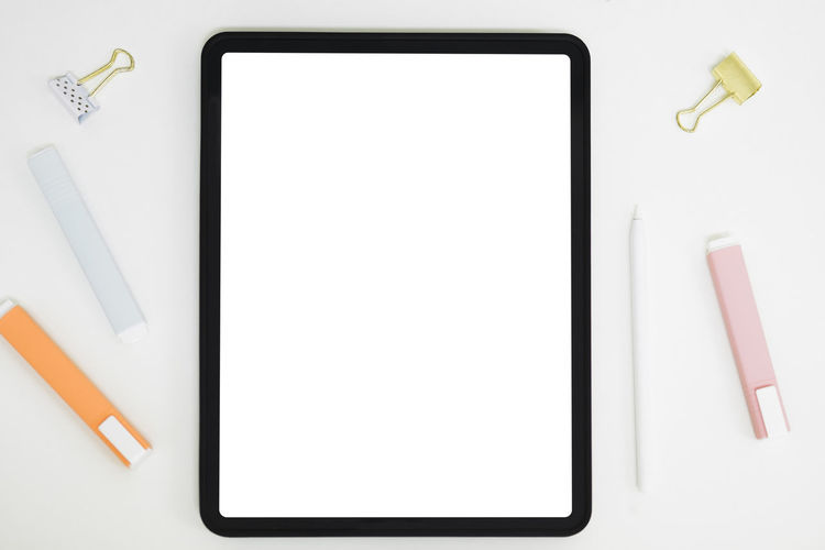 White image of laptop on table