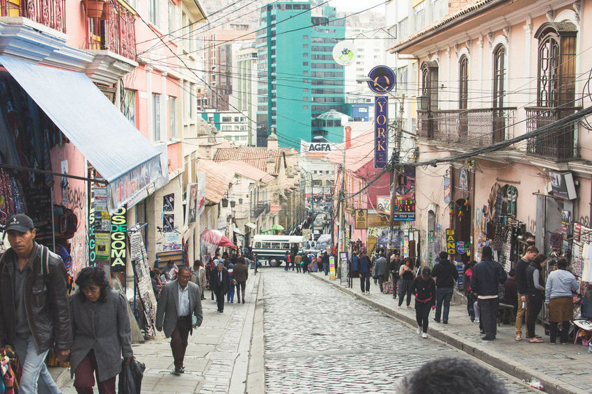 Architecture Building Exterior Built Structure City Large Group Of People City Life Street Person Walking Residential Building Men Travel Destinations City Street Crowd Office Building Narrow Rush Hour Street Market Day Modern Residential District Bolivia La Paz La Paz, Bolivia Building