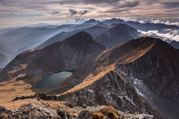 Fagaras Mountains, Romania Autumn Light Nature Tranquility Beauty In Nature Clouds Lake Landscape Mountains Outdoors Ridge Sky Sunset Tranquil Scene Travel Destinations Water