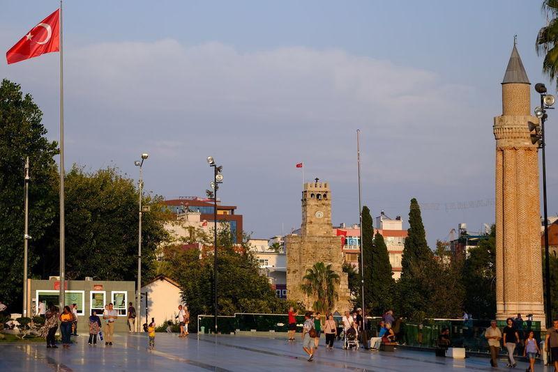 The old clock tower and its surrounding in the center of Antalya Turkey Türkei Antalya Clock Tower Uhrturm Kaleiçi Minarett Turkish Flag