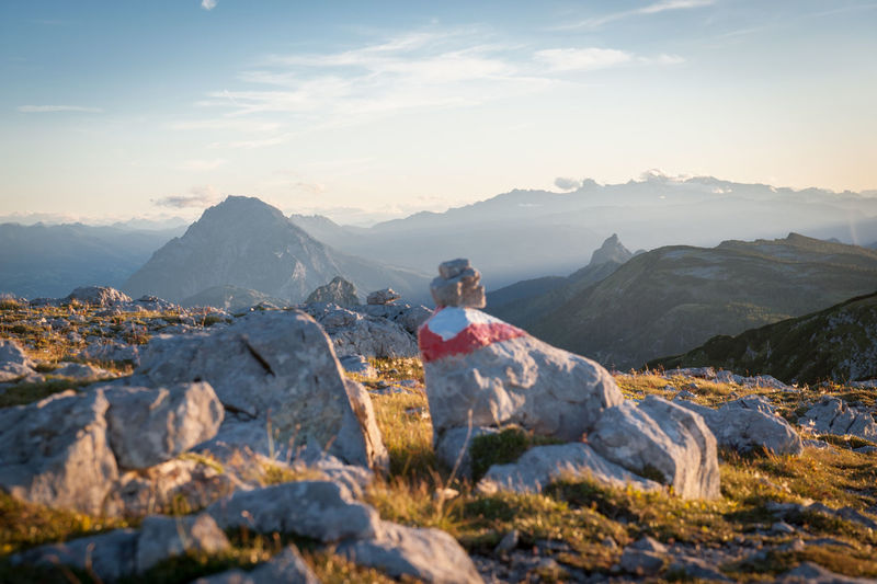 Watching the sun go down Mountain Sky Scenics - Nature Mountain Range Beauty In Nature Nature Environment Tranquil Scene Tranquility Solid Landscape Leisure Activity Rock Cloud - Sky Rock - Object Day Idyllic Non-urban Scene One Person Adventure Outdoors Mountain Peak Hiking Path