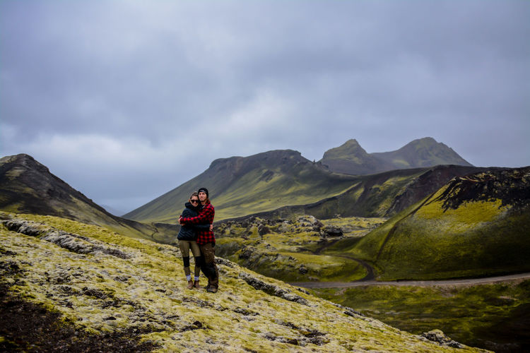 Couples In Love Green Iceland Love Travel Backpack Beauty In Nature Casual Clothing Cloud - Sky Day Full Length Hiking Leisure Activity Lifestyles Mountain Nature One Person Outdoors People Real People Scenics Sky Standing Walking Young Adult