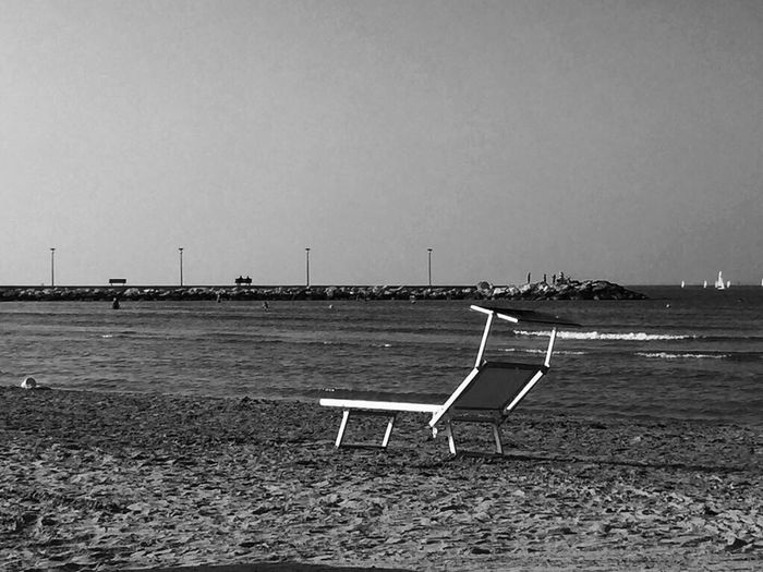 Absence Clear Sky Empty Chair Bench Water Sand Beach Outdoors Seat Relaxation Tranquility Tranquil Scene Sun Lounger Sea Nature Deck Chair Sky No People Italy Fano Marche Blackandwhite