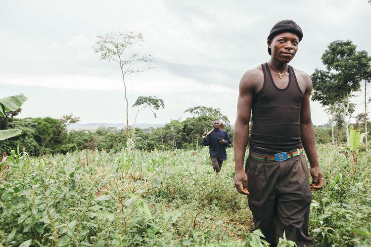Africa African Agriculture Crops Dirt Farm Farm Worker Farming Fruit Growing Harvest Hoe Lifestyles Man Men Outdoors Pineapple Plantation Plants Real People Rural Scene Village Walking Worker Working