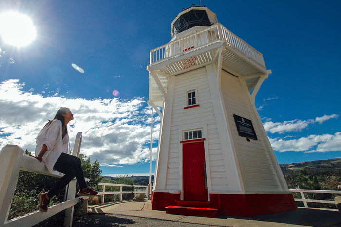 Akaroa Akaroa, New Zealand Architecture Built Structure Coastal Life Day Fisherman Village Guidance Guiding Light Happy Head Lighthouse Landmark Lifestyles Lighthouse Nature New Zealand Sea Self Portrait Sky Summertime Sunlight Sunny Travel White Working Holiday  Done That.