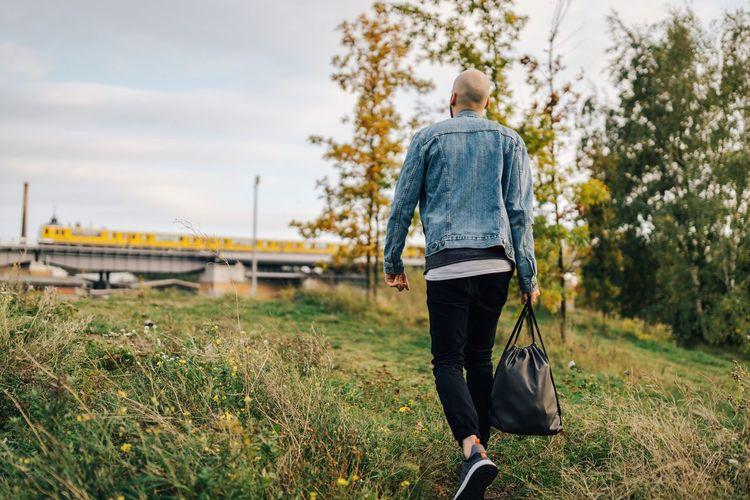 Heading to the train 🚈 Rear View Walking Bag One Person Casual Clothing Carrying Backpack Leisure Activity Lifestyles Outdoors People Luggage Adult Grass Train Ubahn Ubahn Berlin Man Model Journey Traveler Traveling Commuting Moving Forward  Berlin