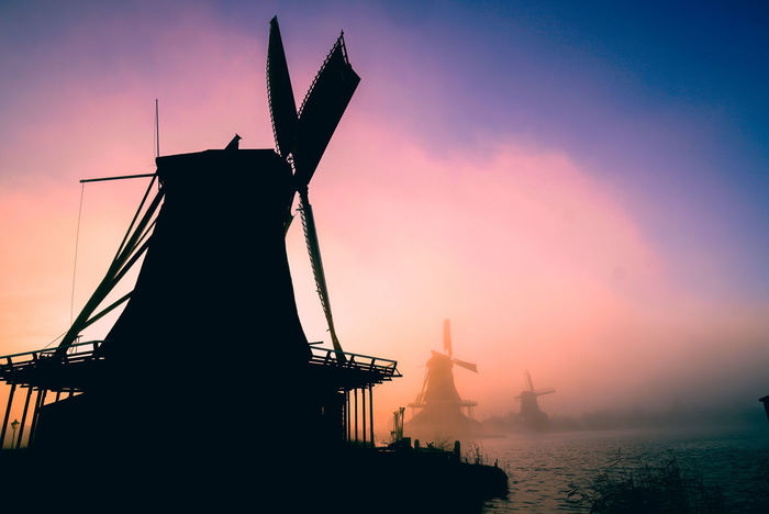 Dutch windmills in Zaanse Schans, Netherlands. Windmill Windmills Water Power Cloud Amsterdam Amsterdam Canal Netherlands Holland Dutch Zaanse Schans Zaanse Schans Postcards Zaanseschanswindmill Europe Europe Trip Eu Foggy Mist Morning Nautical Vessel Outdoors Alternative Energy Fuel And Power Generation No People Agriculture Sky Industry Technology Dawn Day