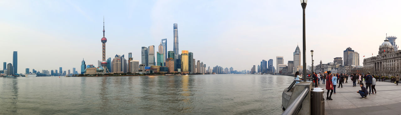 The Bund With Cityscape And River Against Sky