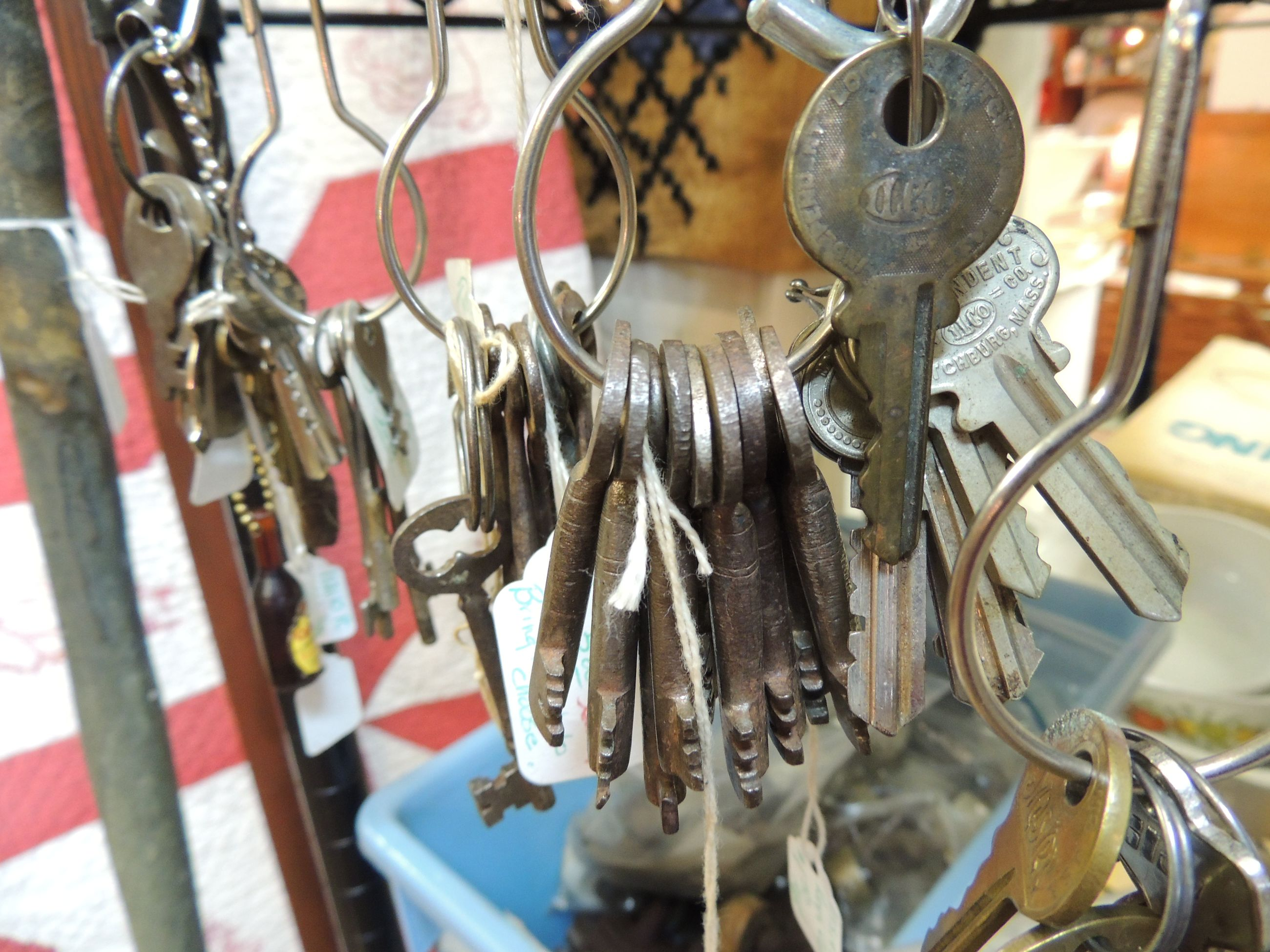 metal, hanging, close-up, focus on foreground, large group of objects, metallic, indoors, padlock, abundance, still life, no people, day, lock, mode of transport, selective focus, in a row, transportation, protection, variation