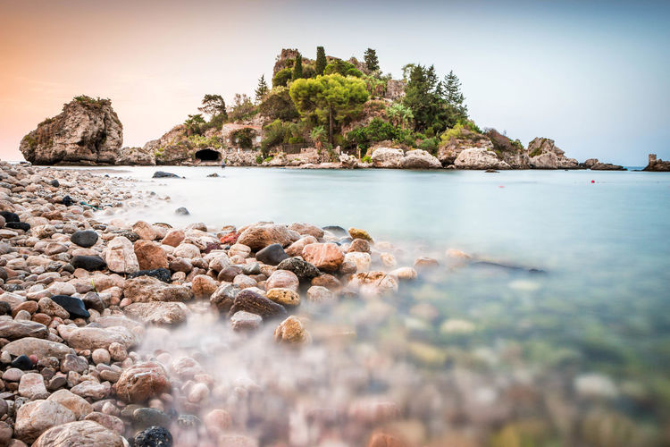 Isola Bella, Sicily Water Rock Sea Rock - Object Solid Scenics - Nature Tranquility Land Beauty In Nature Sky Nature Tree Plant Tranquil Scene Beach Day No People Idyllic Outdoors Surface Level Pebble Shallow Catalunya Sicily Taormina
