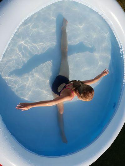 Girl sitting in wading pool