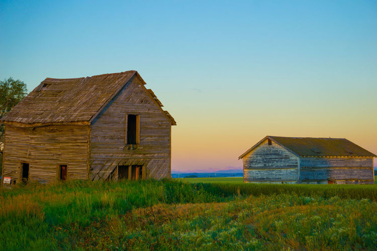 Forgotten Memories Abandoned Architecture Barn Building Exterior Built Structure Clear Sky Country House Day Farmhouse Field Grass House Nature No People Outdoors Scenics Sky Tranquility