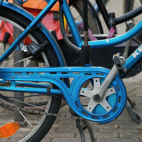 Close-up of bicycle wheel in rack