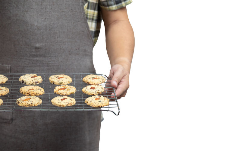 Midsection of person holding cookies