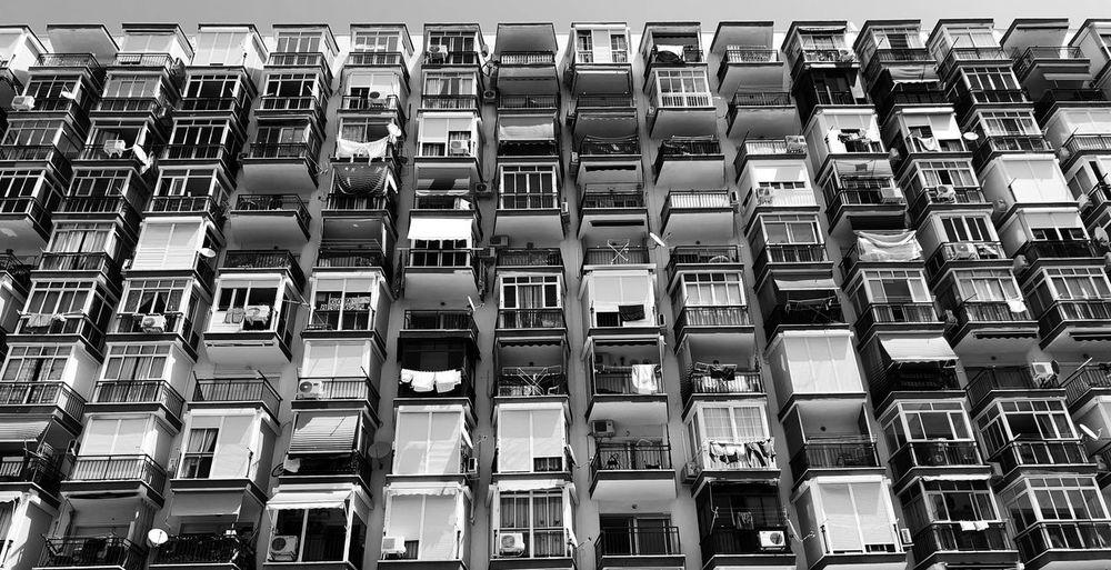 Full frame shot of balconies in building