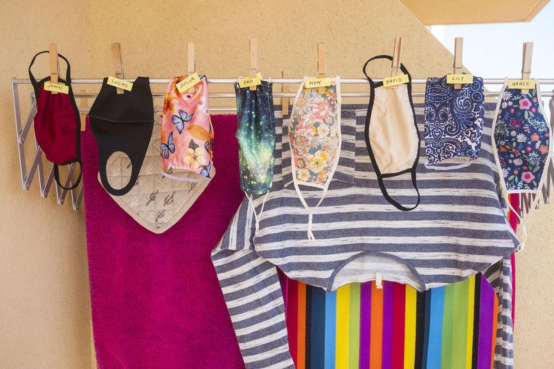Protective face masks hanging on clothesline