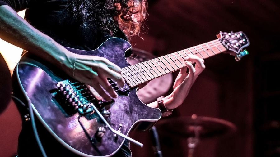 Musical Instrument Music Guitar Arts Culture And Entertainment Musical Equipment String Instrument Performance Event Indoors  Modern Rock Artist Rock Music Playing Electric Guitar Guitarist Stage - Performance Space Musician Stage Enjoyment Night
