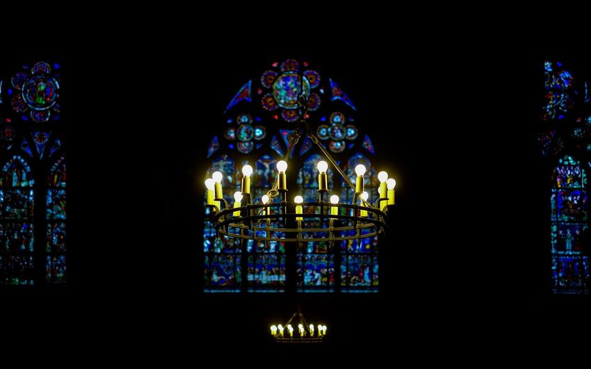 Illuminated Chandelier In Church