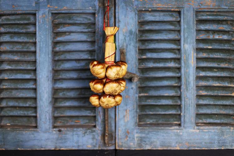 Garlic hanging on wood
