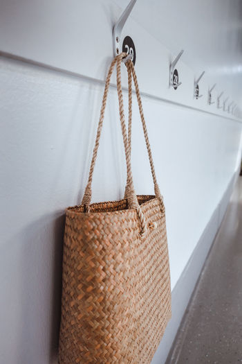 Close-up of bag hanging on wall