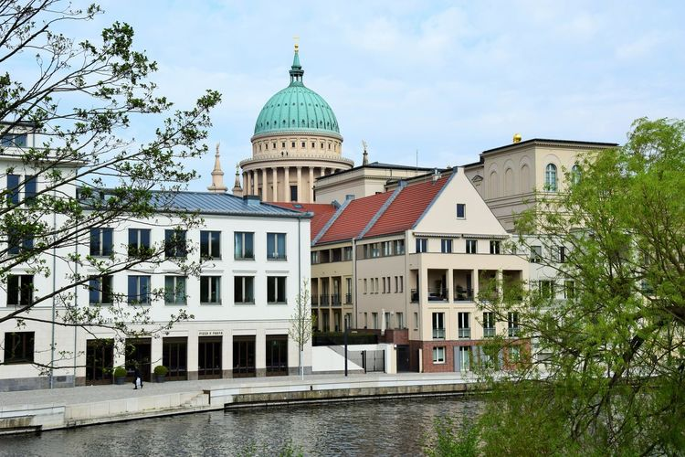 Blick Von Der Freundschaftsinsel City Life Riverside Architecture Belief Building Building Exterior Built Structure City Day Dome Nature No People Outdoors Place Of Worship Plant Religion River Sky Spirituality Spring Travel Destinations Tree Water