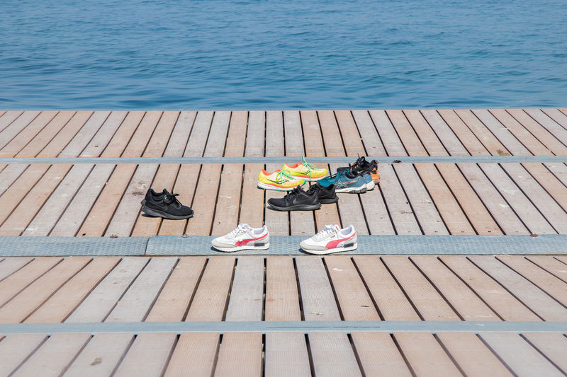 High angle view of people sitting on pier at beach