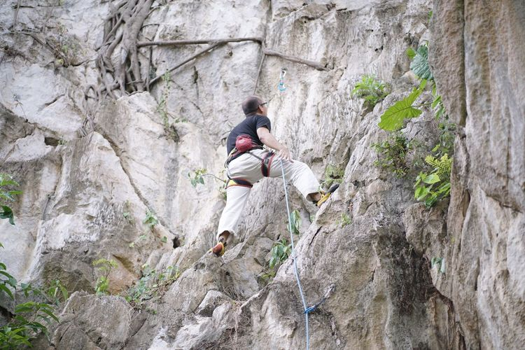 Rock climbing - difficulty 6A Lifestyles Solid Rock - Object Rock Real People Rock Climbing Activity Men Mountain Extreme Sports Adventure Rope Rock Formation Full Length Nature People Plant