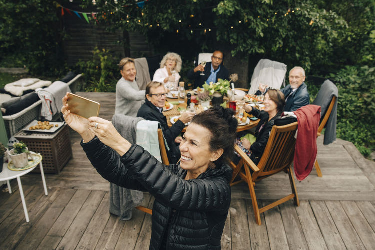 Group of people sitting on table