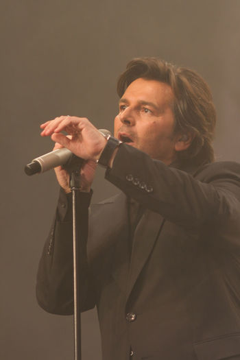 Thomas Anders on a public Fan Club Party concert in February 2009, Koblenz, Germany Celebrity Famous Fan Club German Modern Music Show Sing Stage Thomas Anders Concert Evening Live Microphone Musician One Person Party Portrait Real People Song Songs Talent Talking Voice
