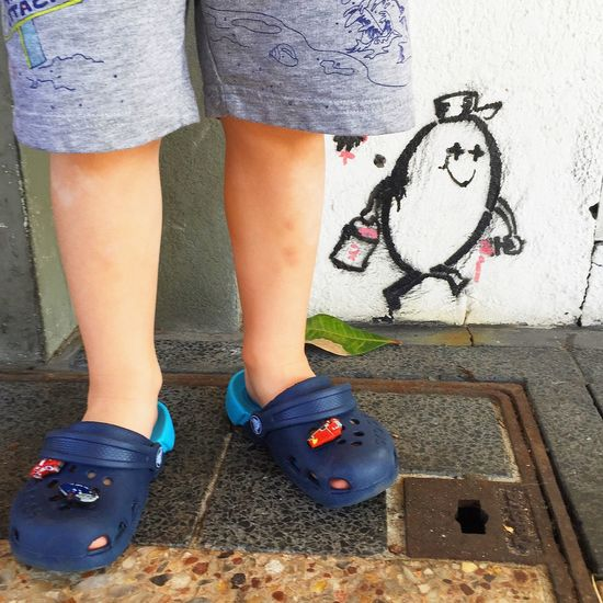Apparel Baby Shoes Casual Clothing Childhood Children Children's Clothing Clothes Feet Footwear Graffiti Graffiti Art Graffiti Wall Human Foot Human Leg Kids Legs Little Little Boy Real People Shoe Shoes Shorts Small Summer Summer Clothes