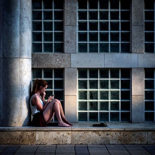 Liberty Square Budapest One Person Adult Sitting Window One Woman Only Only Women Full Length Loneliness City Building Exterior One Young Woman Only Women Architecture Outdoors The Week On EyeEm 2017 Eyeem Awards EyeEm Best Shots People Streetphotography Real People