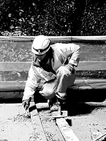 One Person Looking Down Adult Outdoors Headwear Working Real People Hardhat  Night Concreting Black And White Photography