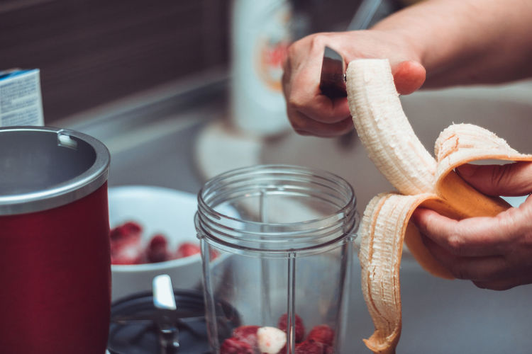 Banana Breakfast Morning Chef Close-up Container Food Food And Drink Freshness Fruit Healthy Eating Healthy Food Healthy Lifestyle Human Hand Indoors  Kitchen Making One Person Preparation  Preparing Food Smoothie Women
