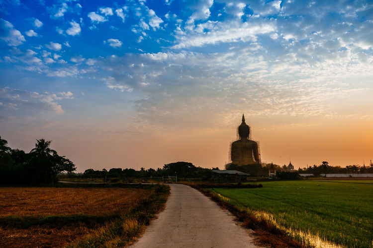 road to religion City Sunset Cultures Religion History Sky Architecture Countryside Statue Sculpture Buddha Sculpted Place Of Worship Golden Color