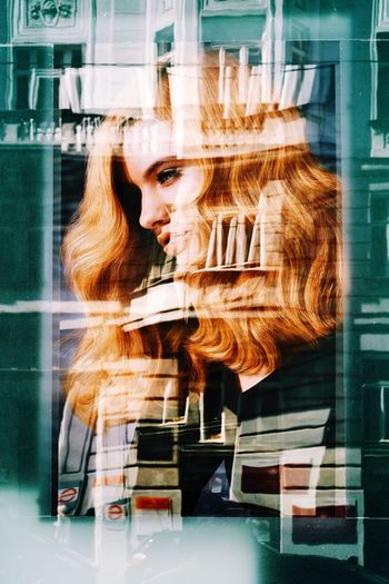 Digital composite image of woman looking through window