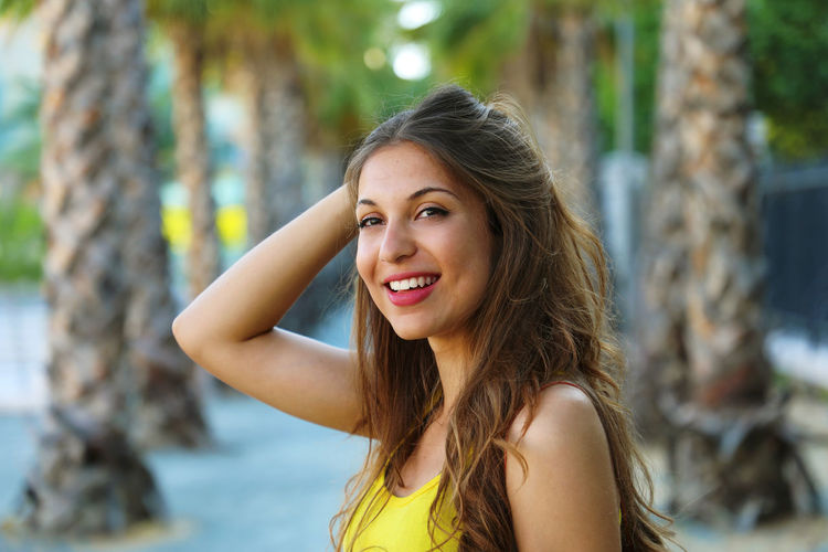 Beautiful woman in Malaga Malaga Malagueta Beach Beautiful Woman Beauty Focus On Foreground Hair Hairstyle Lifestyles Long Hair Malagueta One Person Palm Trees Portrait Tree Young Adult Young Women