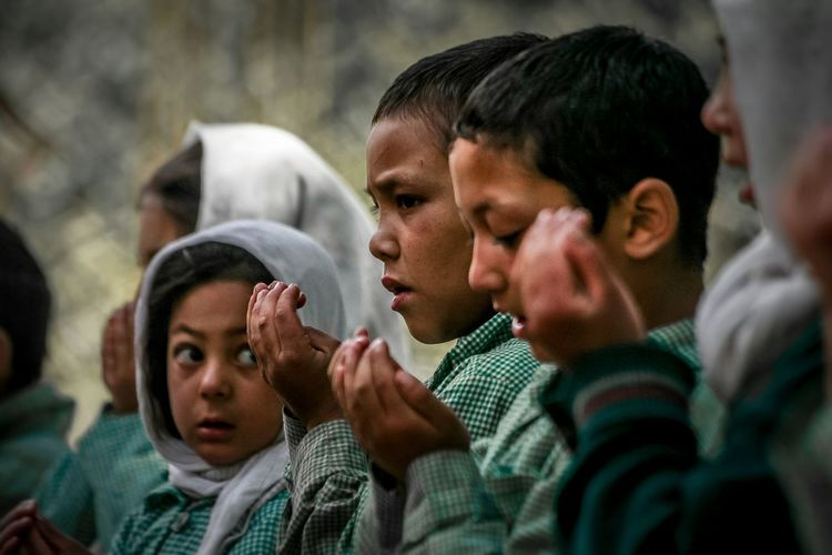 First love in school, a school assembly and the national anthem going on in the background, Turtuk, Kashmir. A small village near India Pakistan border. Prayer Portrait Love Happiness Turtuk Kashmir India Pakistan Border Portrait Photography Kids Kidsphotography Portraits Of EyeEm School Uniform Praying National Anthem Hijab Muslim Assembly Line Headshot Sportsman Friendship Teamwork Togetherness Faith Head And Shoulders EyeEmNewHere Human Connection Capture Tomorrow Moments Of Happiness